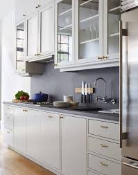 White Inset Kitchen Cabinets by White Slab Inset Doors With Brass Gold Hardware And Soapstone