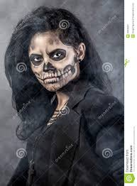 woman with mask skull halloween face art stock photography