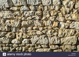 rough random stone wall texture france stock photo royalty free
