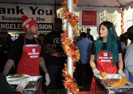 jenner and tyga serve up meals for homeless on thanksgiving