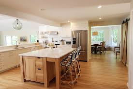classic white modern kitchen with white oak island bar stools