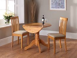 Small Dinner Table by Antique Round Oak Dining Table Leaves Stow Away Safely On Felt