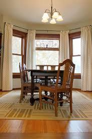 dining rooms area rug flower in vase decorative storage cabinet