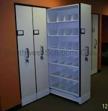 file cabinet with pull out shelf pull out wall shelving quick space sliding cabinets images