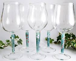 wine glasses and flowers a flame with desire
