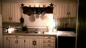 kitchen tin backsplash tin backsplash white barn wood cabinets with vintage hardware