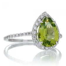 peridot engagement rings engagement ring 10x7 pear diamond halo band