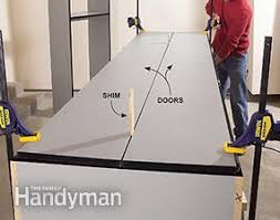 Build Wood Garage Cabinets by Build The Ultimate Garage Cabinets Yourself Family Handyman