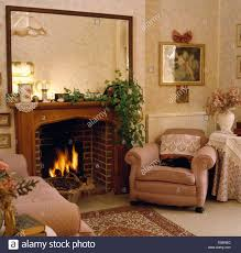 large mirror above fireplace with lighted in eighties living