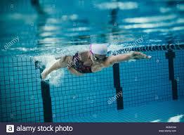 inside swimming pool underwater shot of female swimmer in action inside swimming pool