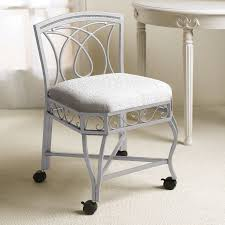 gilded wrought iron bathroom bench with rounded pink velvet