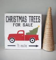 tree truck with tree wood sign