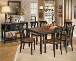 affordable dining room furniture signature design by ashley owingsville 7 piece rectangular dining