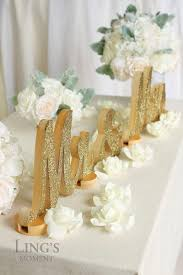 bride and groom sweetheart table glitter letters mr and mrs sweetheart table chagne glitter mr and