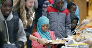 refugees celebrate thanksgiving with all the fixings in rochester