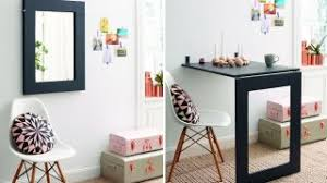 this diy desk saves space folds up into a wall mirror when not in use