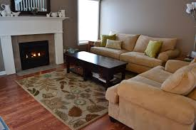 charming white living room applying wooden flooring with fireplace