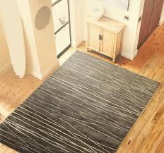 corrigan studio primavera tufted taupe area rug reviews