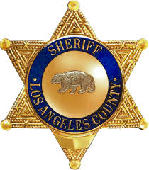 why does the la county sheriff badge have a symbol on