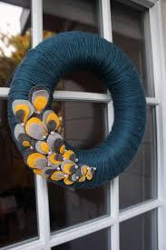 best 25 yarn wreaths ideas on pinterest diy yarn wreath