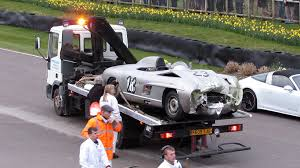 rarest cars rare lister jaguar and mercedes 300 sls poster crash at goodwood