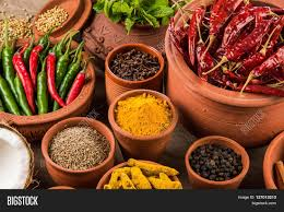 indian spices in terracotta pots indian colourful spices group