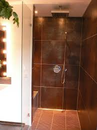 black shower room with rectangle white bath up beside toilet long