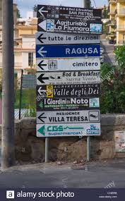 street and hotels signs noto cily sicily italy europe stock photo