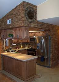 decor faux stone wall with lights and cabinets for kitchen