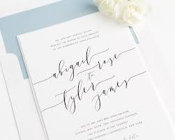 wedding invitations calligraphy calligraphy wedding invitations in dusty blue wedding