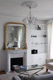 white marble fireplace gold mirror chandellier paris home decor