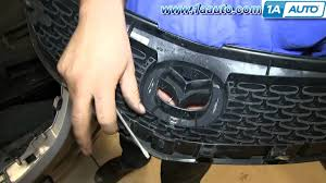 mazda car emblem how to install replace fix broken grille mazda 3 youtube