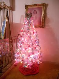 white tree with pink lights lights decoration