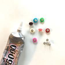 plastic bottle earrings make these rainbow candy button earrings