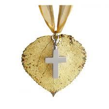 gold aspen leaf cross keepsake in the light urns