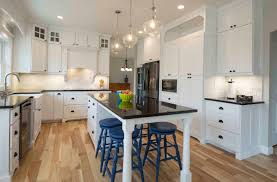 kitchen with white inset shaker cabinets stacked glass cabinets