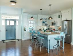 coastal kitchen with blue gray kitchen island off white cabinets