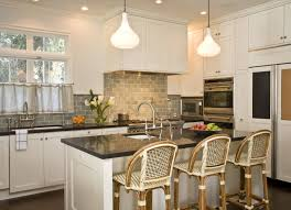 granite countertop white kitchen cabinets blue walls