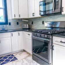 white cabinets with black countertops and backsplash absolute black granite