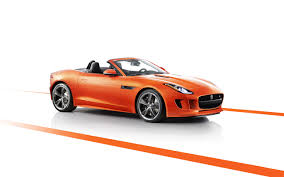 jaguar car wallpaper orange jaguar car wallpaper 8129 2560 x 1600 wallpaperlayer com