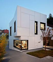 Interior Design Of Home by Box Shaped House Design With Elegant Exterior Wall White Color