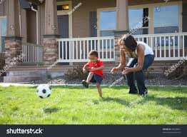 mother son front yard playing soccer stock photo 36228661