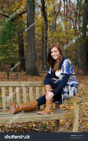 bench photo young beautiful woman siting on bench outdoors and