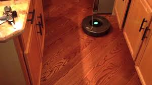 irobot roomba 780 in kitchen with island and hardwood floors hd