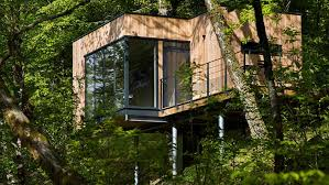 a stay in the treetops cool treehouses you can sleep in around