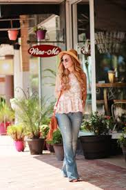 peplum and flared jeans outfit upbeat soles florida style blog orlando florida fashion blog styles blush and brulee floral peplum with american eagle flared jeans
