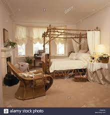 White Wicker Bedroom Chairs White Cane Chair In Bedroom With Metallic Floral Print Wallpaper