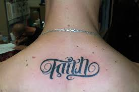 ambigram faith lettering tattoo on man upper back