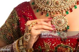 traditional dress up of indian weddings closeup of an indian in traditional wedding dress stock