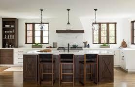 Mediterranean Style Kitchens - dark wood mediterranean style island with 3 glass light pendants